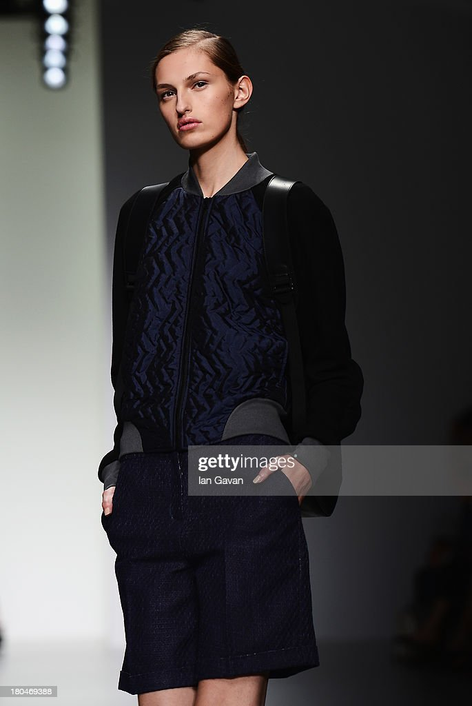 A model walks the runway at the Christopher Raeburn show during London Fashion Week SS14 at BFC Courtyard Showspace on September 13, 2013 in London, England.