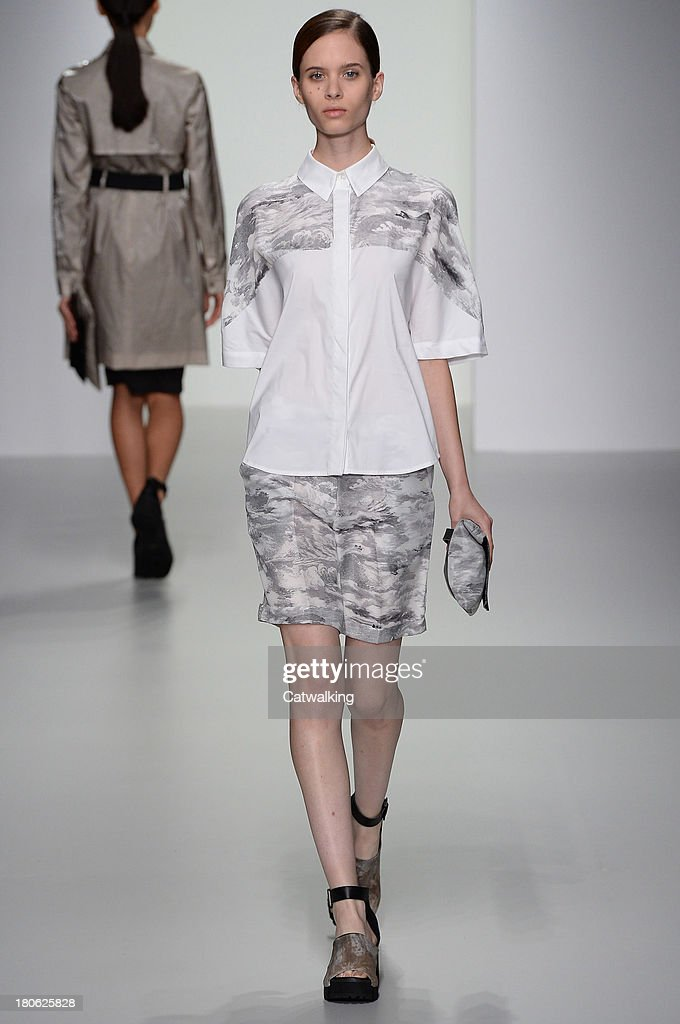 A model walks the runway at the Christopher Raeburn Spring Summer 2014 fashion show during London Fashion Week on September 13, 2013 in London, United Kingdom.