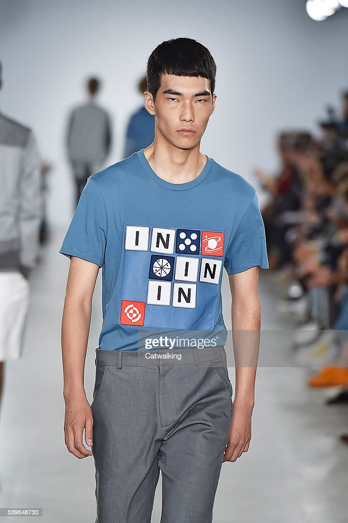 A model walks the runway at the Christopher Raeburn Spring Summer 2017 fashion show during London Menswear Fashion Week on June 12 2016 in London...