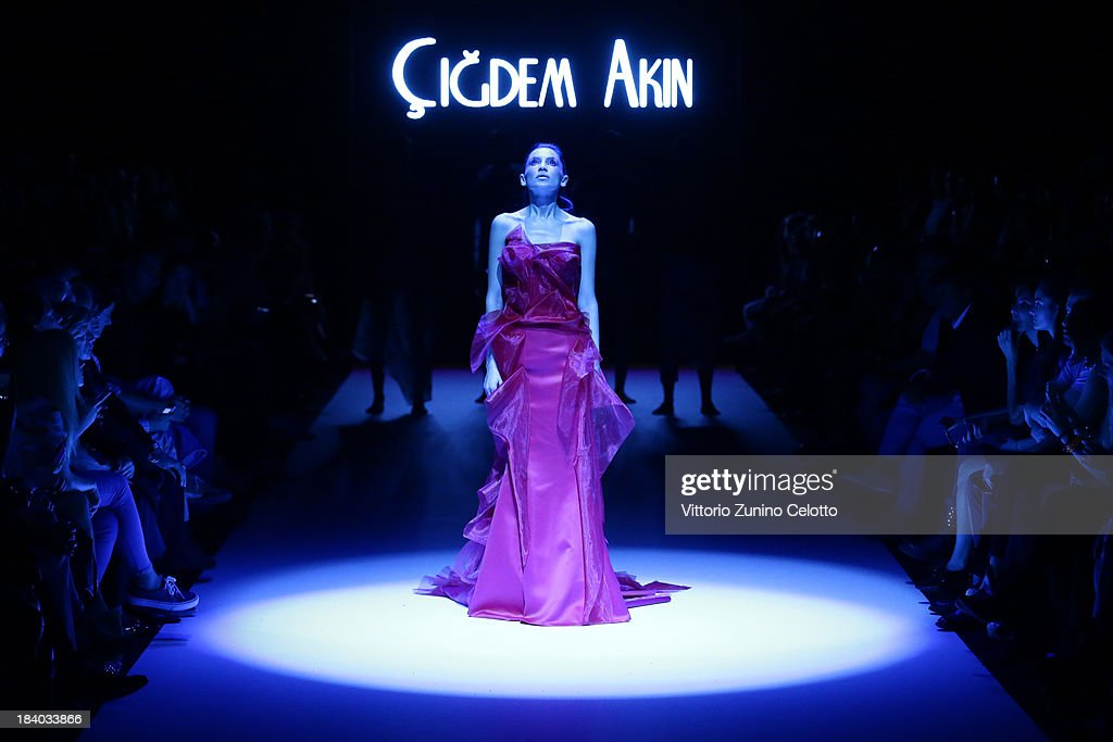 A model walks the runway at the Cigdem Akin show during Mercedes-Benz Fashion Week Istanbul s/s 2014 Presented By American Express on October 11, 2013 in Istanbul, Turkey.