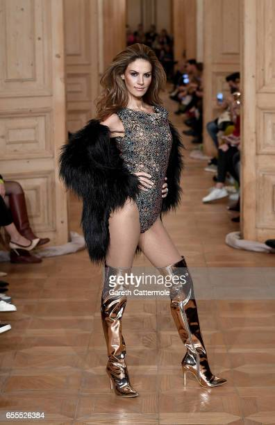 A model walks the runway at the Cihan Nacar show during MercedesBenz Istanbul Fashion Week March 2017 at Grand Pera on March 20 2017 in Istanbul...