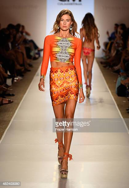 A model walks the runway at the CM CiaMaritima Swimwear fashion show during MercedesBenz Fashion Week Swim 2015 at Cabana Grande at The Raleigh on...