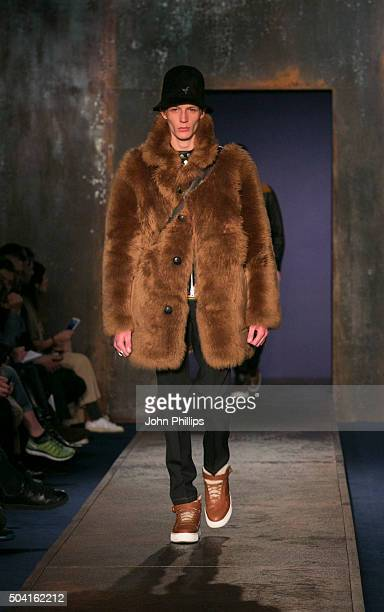 A model walks the runway at the Coach show during The London Collections Men AW16 at Lindley Hall on January 9 2016 in London England