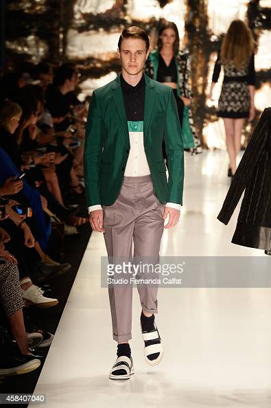 A model walks the runway at the Colcci fashion show during Sao Paulo Fashion Week Winter 2015 at Parque Candido Portinari on November 4 2014 in Sao...