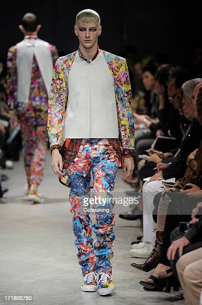 A model walks the runway at the Comme Des Garcons Homme Plus Spring Summer 2014 fashion show during Paris Menswear Fashion Week on June 28 2013 in...