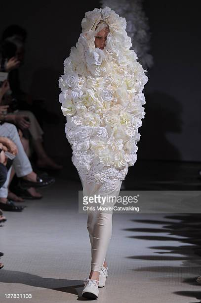 A model walks the runway at the Comme Des Garcons Spring Summer 2012 fashion show during Paris Fashion Week on October 1 2011 in Paris France