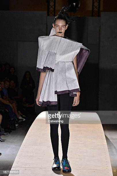 A model walks the runway at the Comme des Garcons Spring Summer 2014 fashion show during Paris Fashion Week on September 28 2013 in Paris France