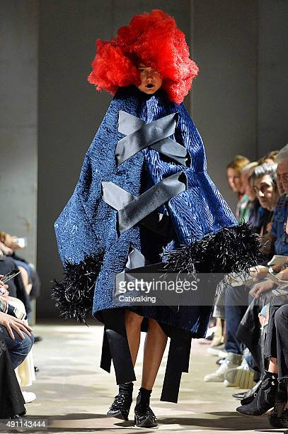 A model walks the runway at the Comme Des Garcons Spring Summer 2016 fashion show during Paris Fashion Week on October 3 2015 in Paris France