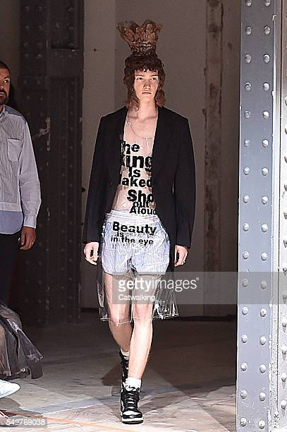 A model walks the runway at the Comme des Garcons Spring Summer 2017 fashion show during Paris Menswear Fashion Week on June 24 2016 in Paris France