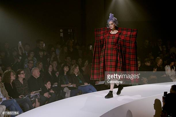 A model walks the runway at the Comme des Garcons Spring Summer 2017 fashion show during Paris Fashion Week on October 1 2016 in Paris France
