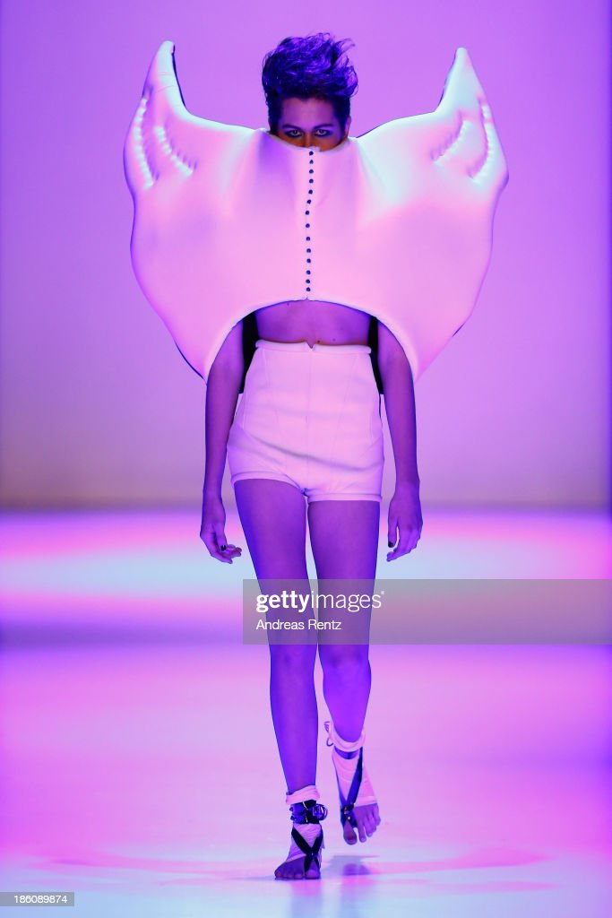 A model walks the runway at the Contrfashion show during Mercedes-Benz Fashion Week Russia S/S 2014 on October 28, 2013 in Moscow, Russia.