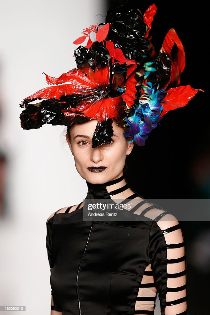 A model (detail) walks the runway at the Contrfashion show during Mercedes-Benz Fashion Week Russia S/S 2014 on October 28, 2013 in Moscow, Russia.