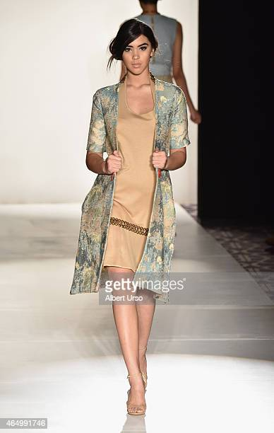 A model walks the runway at the Cosmopolitan Emerging Designers runway show featuring the Crystian Amir collection during MercedesBenz Fashion Week...