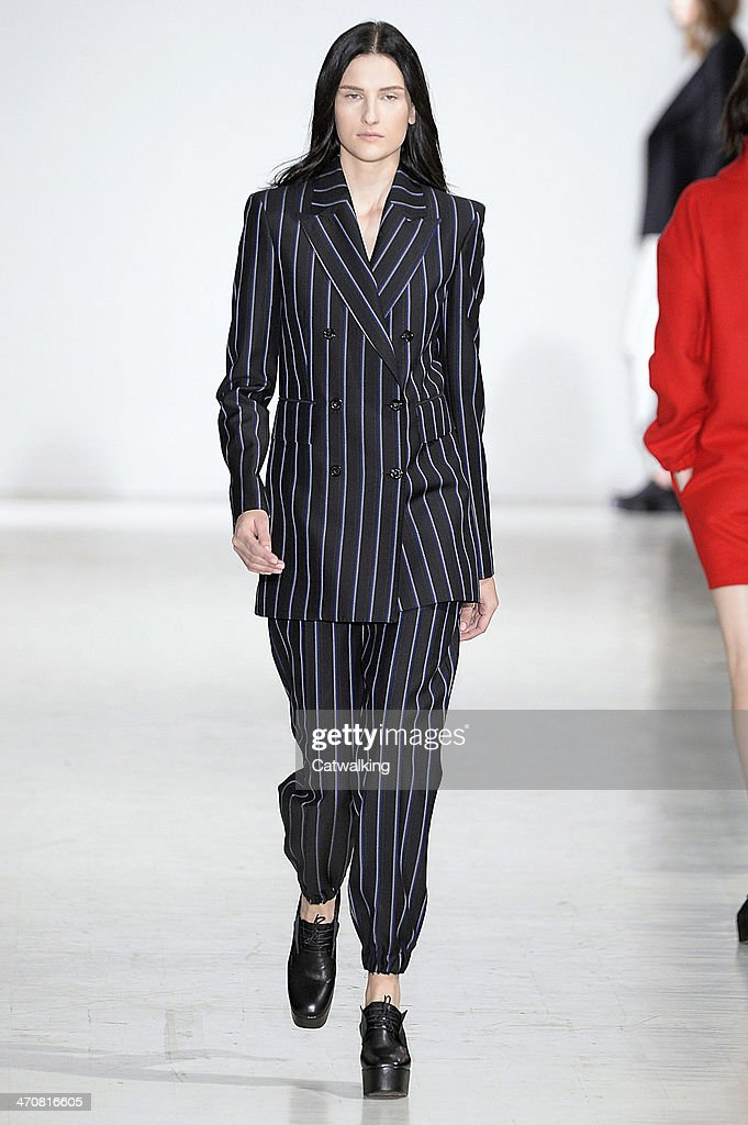 A model walks the runway at the Costume National Autumn Winter 2014 fashion show during Milan Fashion Week on February 20, 2014 in Milan, Italy.
