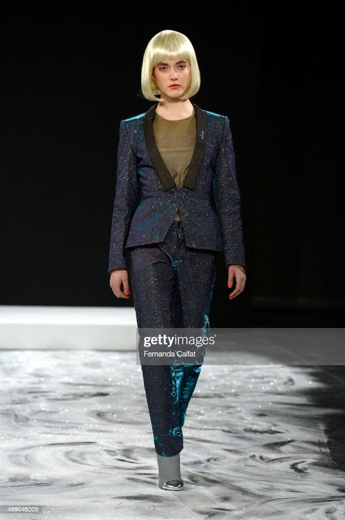 A model walks the runway at the CuteCircuit Fall 2014 fashion show during Mercedes Benz Fashion Week at The Hub at The Hudson Hotel on February 12, 2014 in New York City.