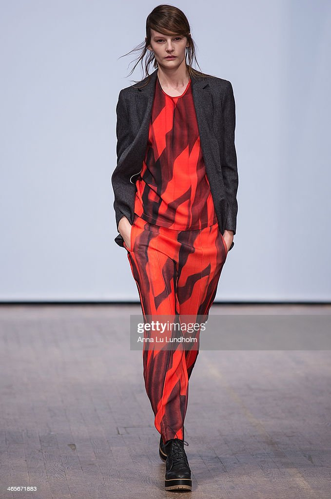 A model walks the runway at the Dagmar show during Mercedes-Benz Stockholm Fashion Week AW14 on January 28, 2014 in Stockholm, Sweden.