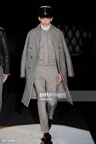 A model walks the runway at the Daks Autumn Winter 2015 fashion show during Milan Menswear Fashion Week on January 18 2015 in Milan Italy