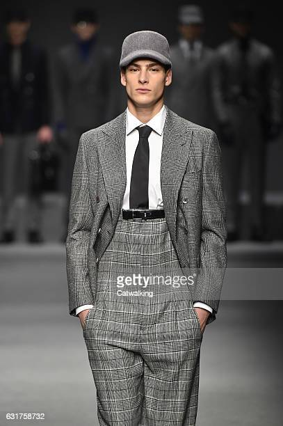 A model walks the runway at the Daks Autumn Winter 2017 fashion show during Milan Menswear Fashion Week on January 15 2017 in Milan Italy