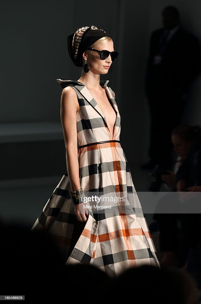 A model walks the runway at the DAKS show during London Fashion Week SS14 at BFC Courtyard Showspace on September 13, 2013 in London, England.