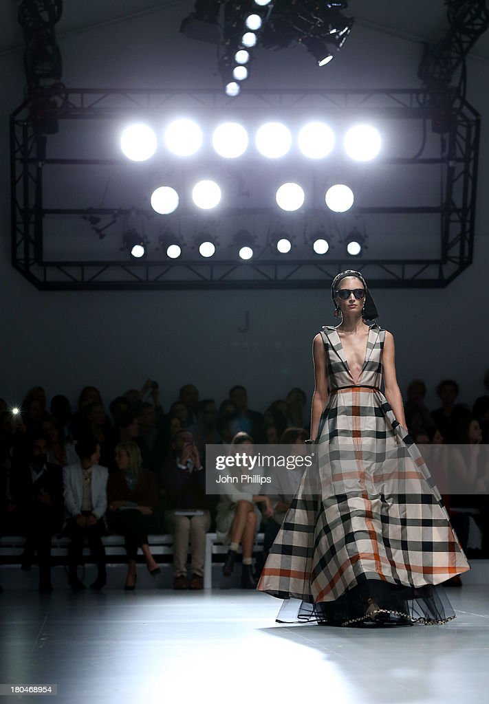 * A model walks the runway at the DAKS show during London Fashion Week SS14 at BFC Courtyard Showspace on September 13, 2013 in London, England.