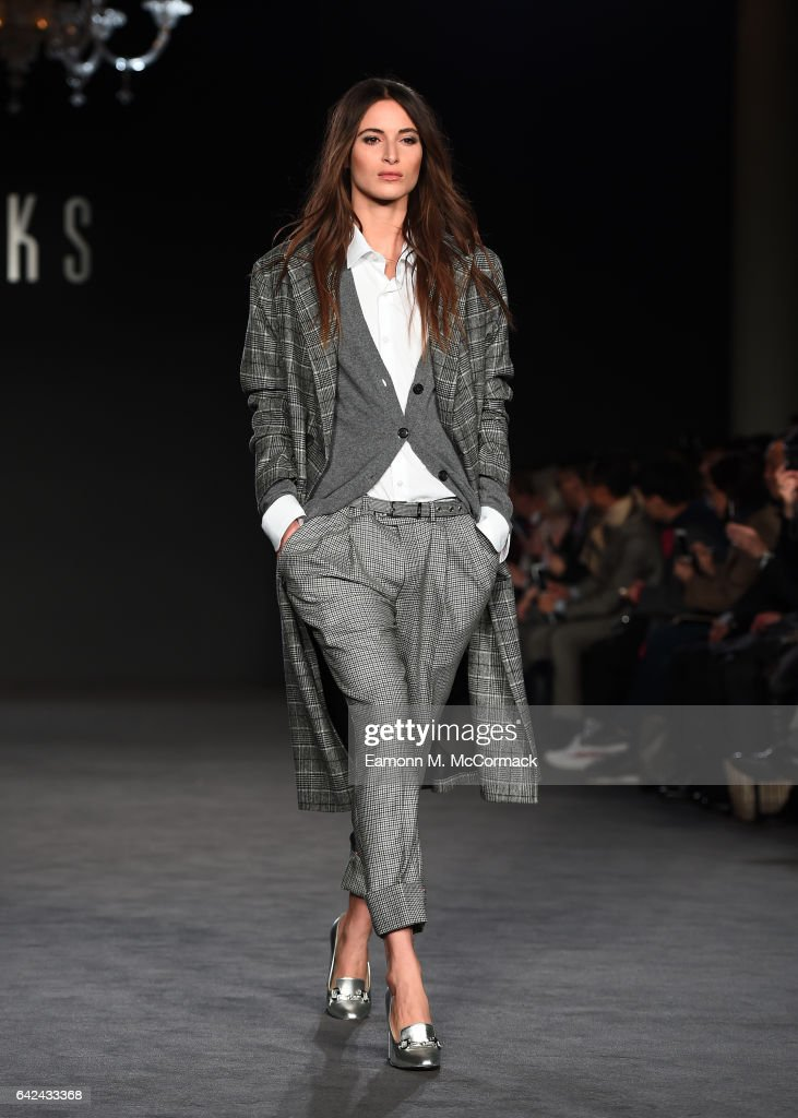 model-walks-the-runway-at-the-daks-show-during-the-london-fashion-picture-id642433368