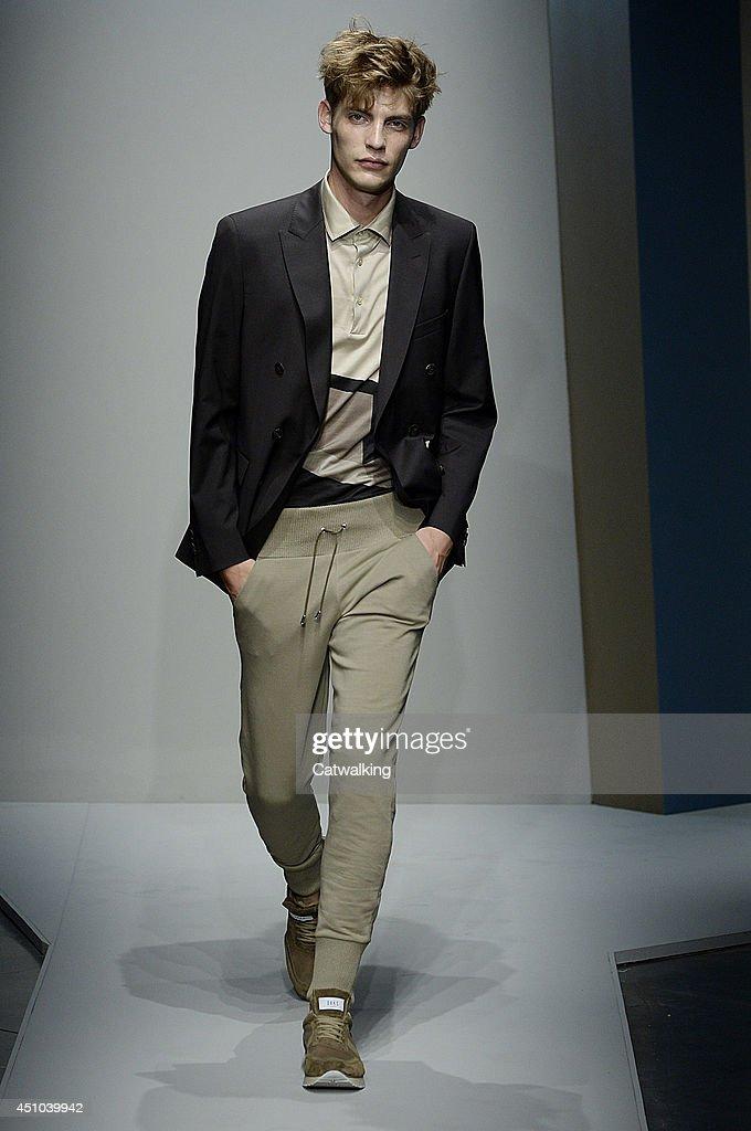 A model walks the runway at the Daks Spring Summer 2015 fashion show during Milan Menswear Fashion Week on June 22, 2014 in Milan, Italy.