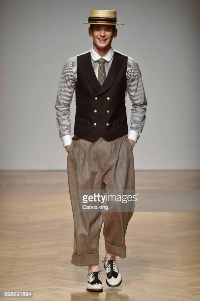 A model walks the runway at the Daks Spring Summer 2018 fashion show during Milan Menswear Fashion Week on June 18 2017 in Milan Italy