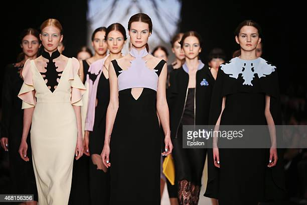 A model walks the runway at the Dasha Gauser show during day 5 of Mercedes Benz Fashion Week Moscow at Manege on March 30 2015 in Moscow Russia