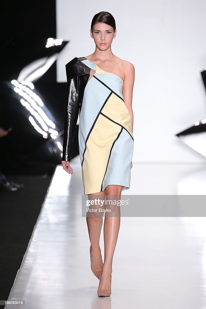 A model walks the runway at the Dasha Gauser show of Mercedes-Benz Fashion Week S/S 14 on October 29, 2013 in Moscow, Russia.