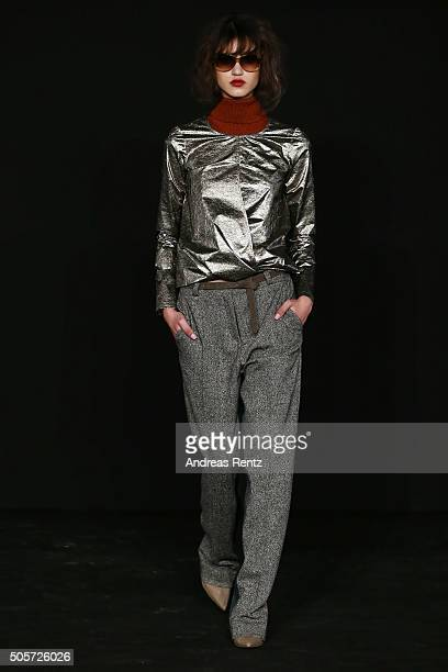 A model walks the runway at the Dawid Tomaszewski fashion show intervention A/W 2016/17 as part of Der Berliner Mode Salon during the MercedesBenz...
