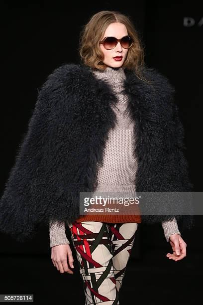 A model walks the runway at the Dawid Tomaszewski fashion show intervention A/W 2016/17 as part of Der Berliner Mode Salon during the MercedesBenz...
