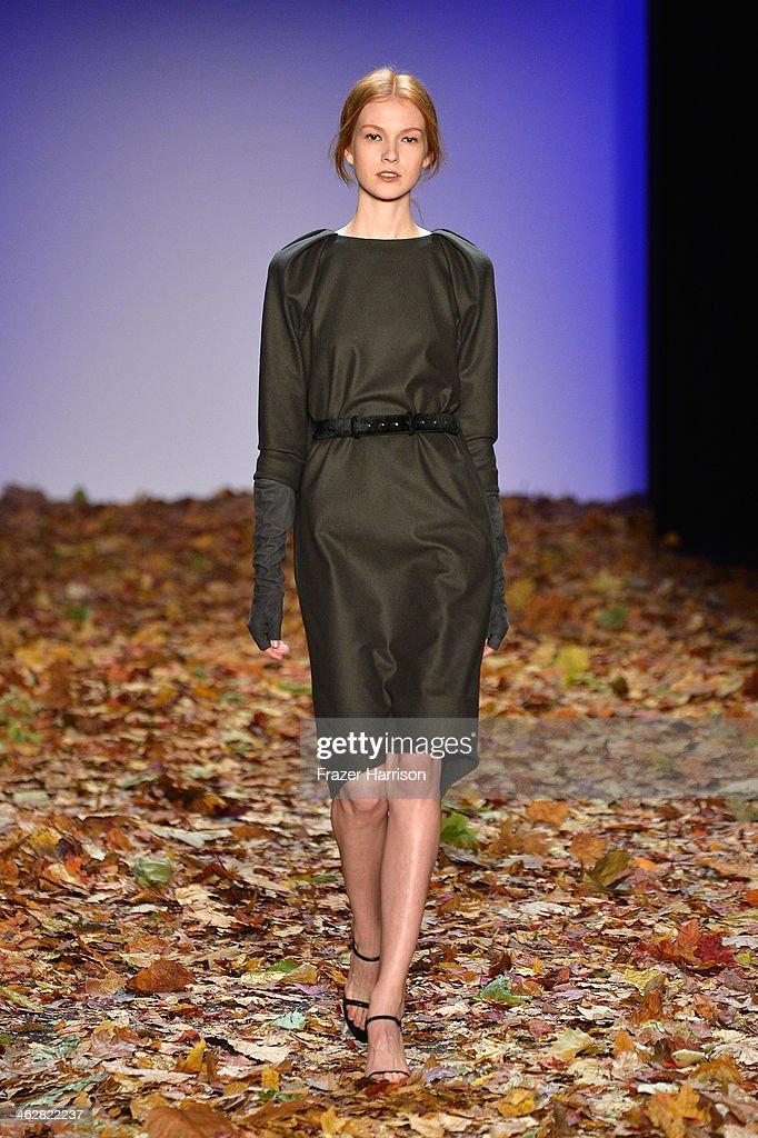 A model walks the runway at the Dawid Tomaszewski show during Mercedes-Benz Fashion Week Autumn/Winter 2014/15 at Brandenburg Gate on January 15, 2014 in Berlin, Germany.