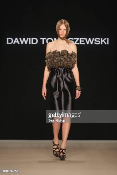 A model walks the runway at the Dawid Tomaszewski Show during the Mercedes Benz Fashion Week Autumn/Winter 2011 at Bebelplatz on January 20 2011 in...