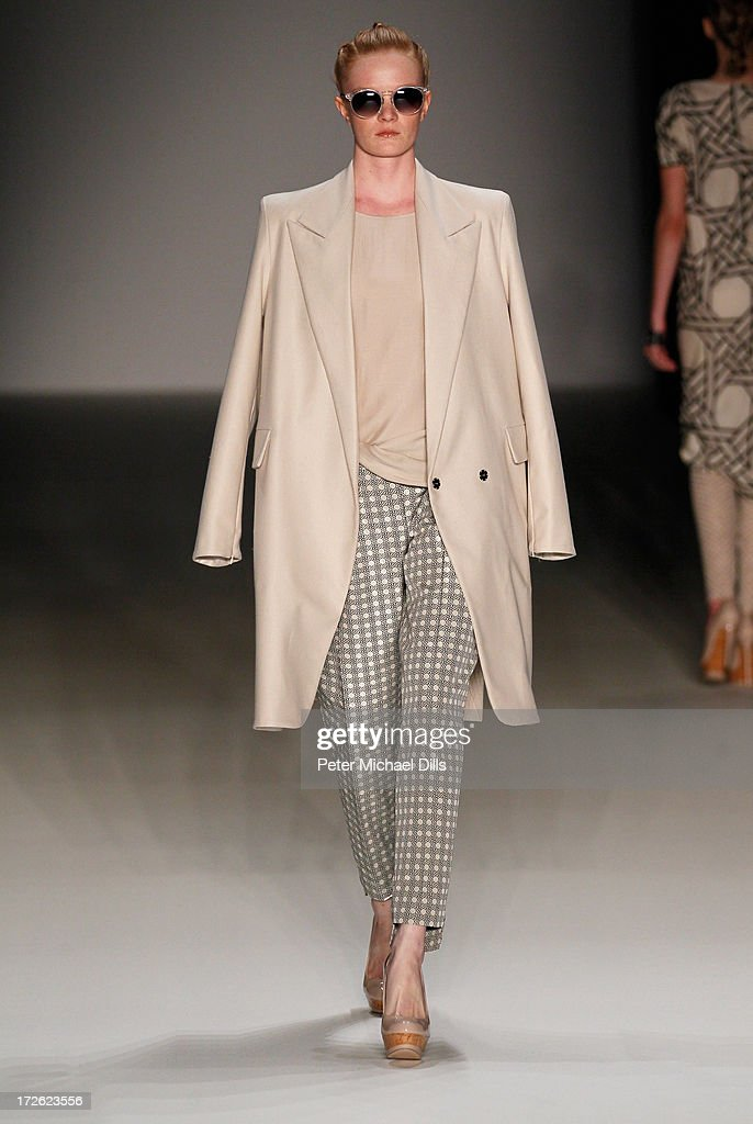 A model walks the runway at the Dawid Tomaszewski Show during the Mercedes-Benz Fashion Week Spring/Summer 2014 at Brandenburg Gate on July 4, 2013 in Berlin, Germany.