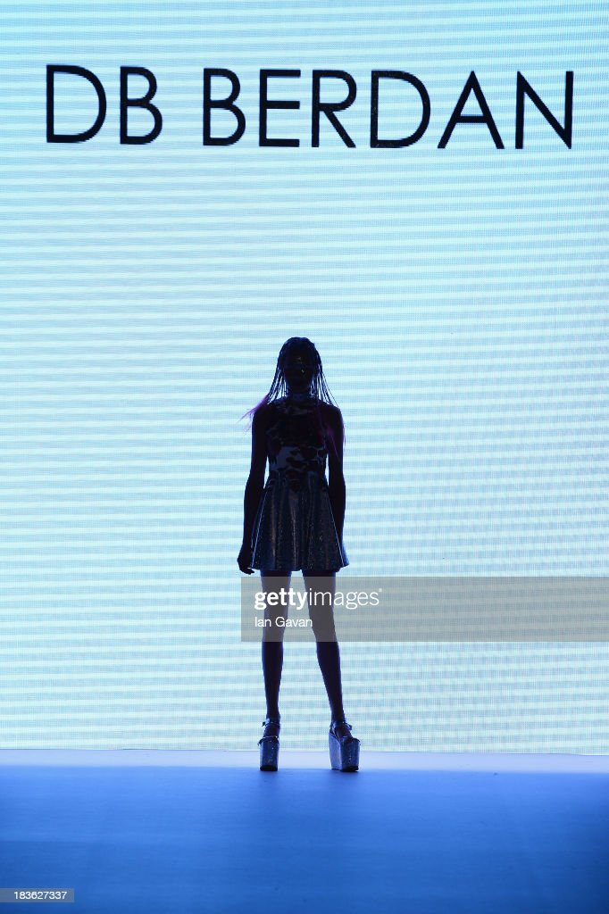 A model walks the runway at the DB Berdan show during Mercedes-Benz Fashion Week Istanbul s/s 2014 presented by American Express on October 8, 2013 in Istanbul, Turkey.