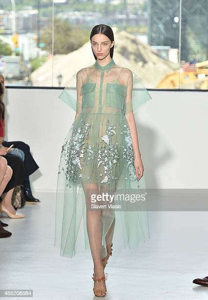 A model walks the runway at the Delpozo fashion show during MercedesBenz Fashion Week Spring 2015 at Location 05 Studios on September 10 2014 in New...