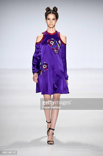 A model walks the runway at the Deola Sagoe / Clan fashion show during MercedesBenz Fashion Week Spring 2015 at The Salon at Lincoln Center on...