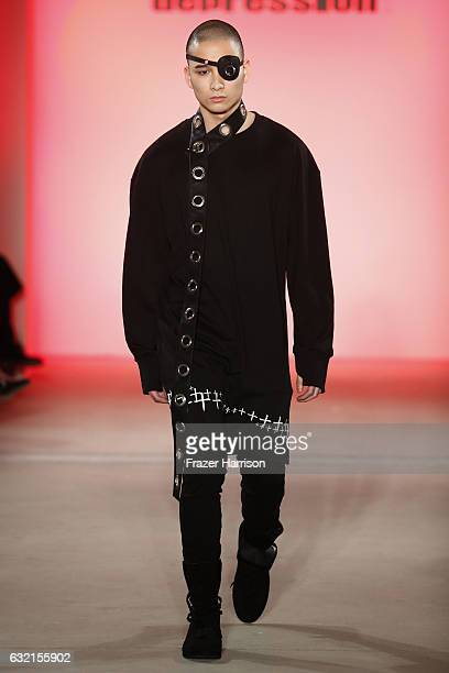 A model walks the runway at the DEPRESSION show during the MercedesBenz Fashion Week Berlin A/W 2017 at Kaufhaus Jandorf on January 20 2017 in Berlin...
