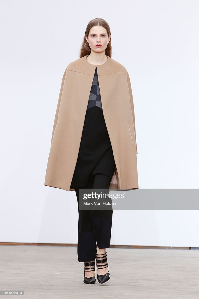 A model walks the runway at the Derek Lam fall 2013 fashion show during Mercedes-Benz Fashion Week at Sean Kelly Gallery on February 10, 2013 in New York City.