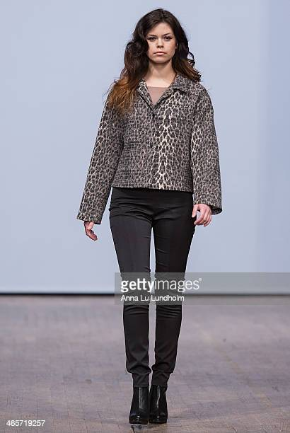 A model walks the runway at the Diana Orving show during MercedesBenz Stockholm Fashion Week AW14 on January 28 2014 in Stockholm Sweden