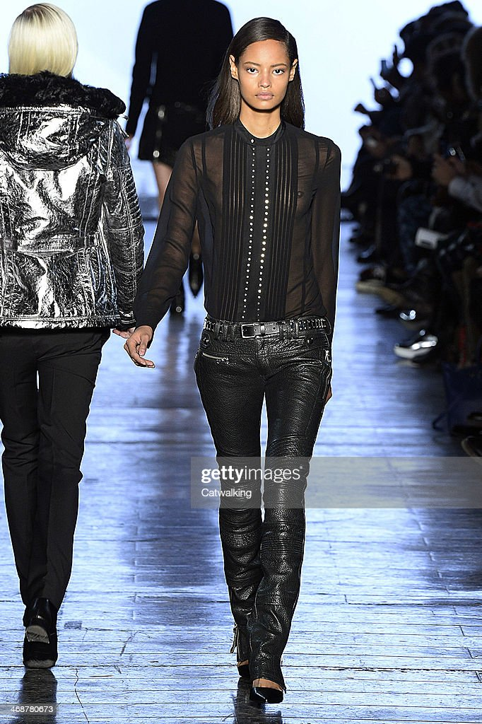 A model walks the runway at the Diesel Black Gold Autumn Winter 2014 fashion show during New York Fashion Week on February 11, 2014 in New York, United States.