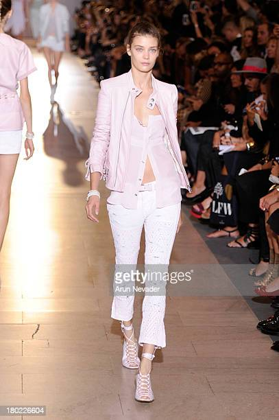 A model walks the runway at the Diesel Black Gold fashion show during MercedesBenz Fashion Week Spring 2014 at Vanderbilt Hall at Grand Central...