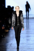 A model walks the runway at the Diesel Black Gold fashion show during MercedesBenz Fashion Week Fall 2014 at Skylight at Moynihan Station on February...