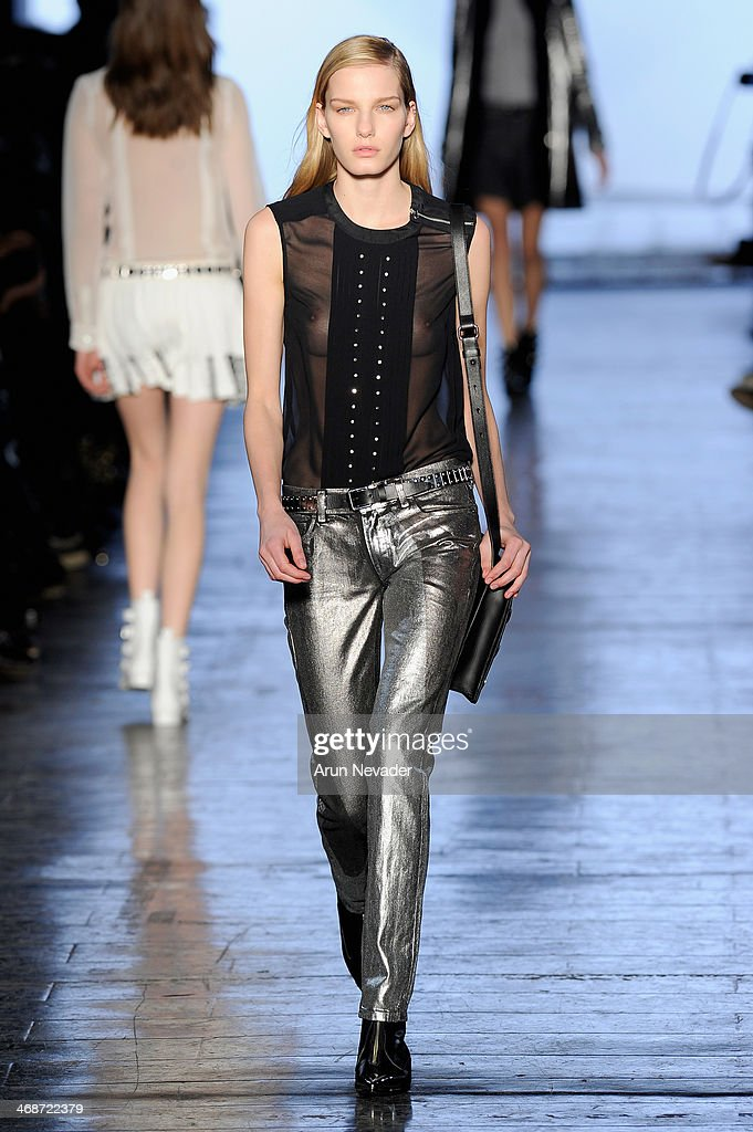 A model walks the runway at the Diesel Black Gold fashion show during Mercedes-Benz Fashion Week Fall 2014 at Skylight at Moynihan Station on February 11, 2014 in New York City.