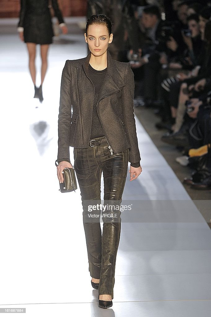 A model walks the runway at the Diesel Black Gold Ready to Wear Fall/Winter 2013-2014 fashion show during Mercedes-Benz Fashion Week at Pier 57 on February 12, 2013 in New York City.