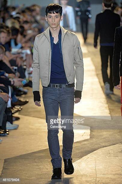 A model walks the runway at the Diesel Black Gold Spring Summer 2015 fashion show during Milan Menswear Fashion Week on June 23 2014 in Milan Italy