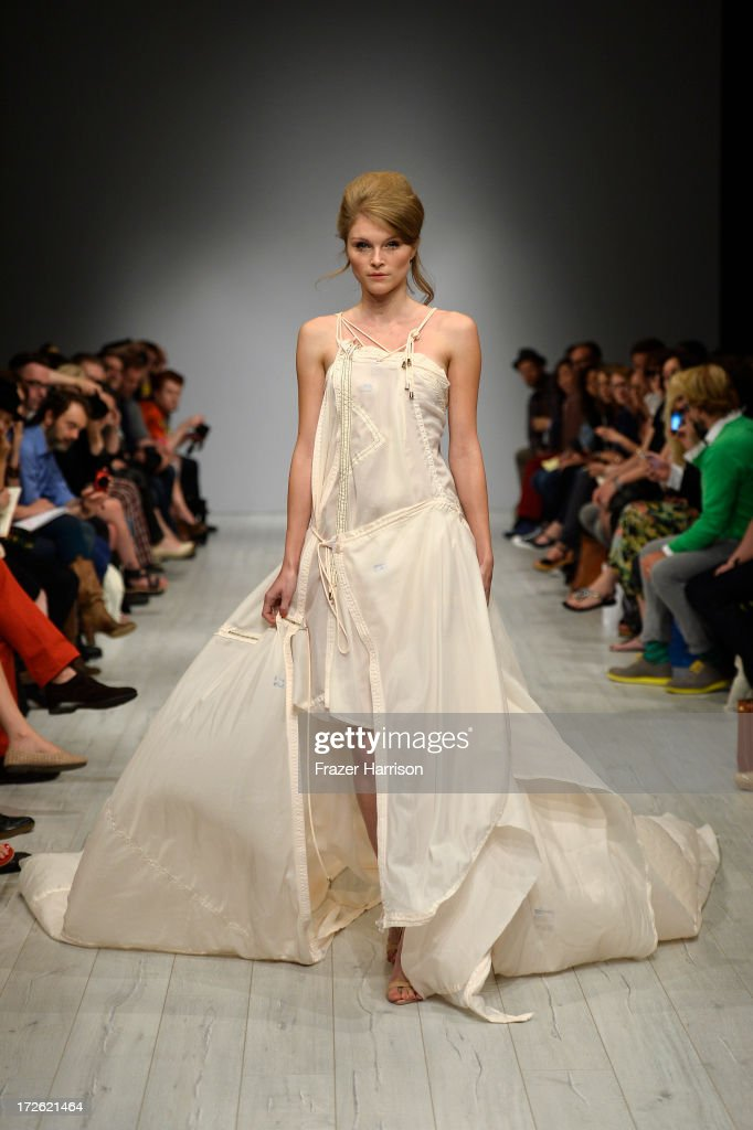 A model walks the runway at the Dietrich Emter Show during the Mercedes-Benz Fashion Week Spring/Summer 2014 at Brandenburg Gate on July 4, 2013 in Berlin, Germany.