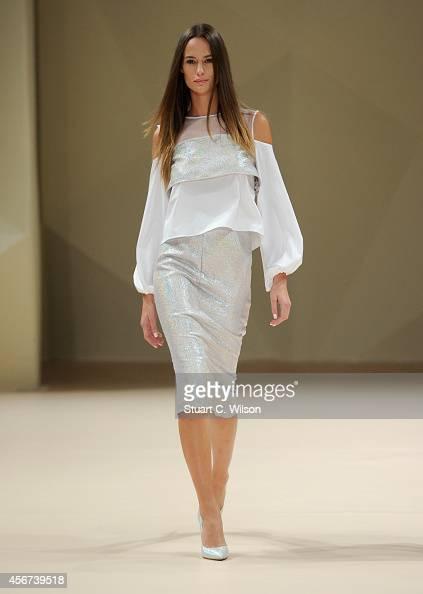A model walks the runway at the Dima Ayad show during Fashion Forward at Madinat Jumeirah on October 6 2014 in Dubai United Arab Emirates