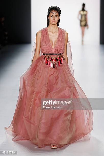 A model walks the runway at the Dimitri show during the MercedesBenz Fashion Week Berlin Autumn/Winter 2015/16 at Brandenburg Gate on January 20 2015...