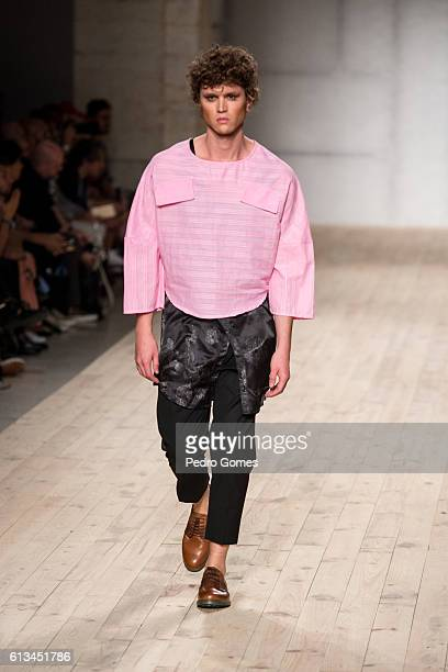 A model walks the runway at the Dino Alves show during Lisboa Fashion Week Spring/Summer 2017 on October 8 2016 in Lisbon Portugal